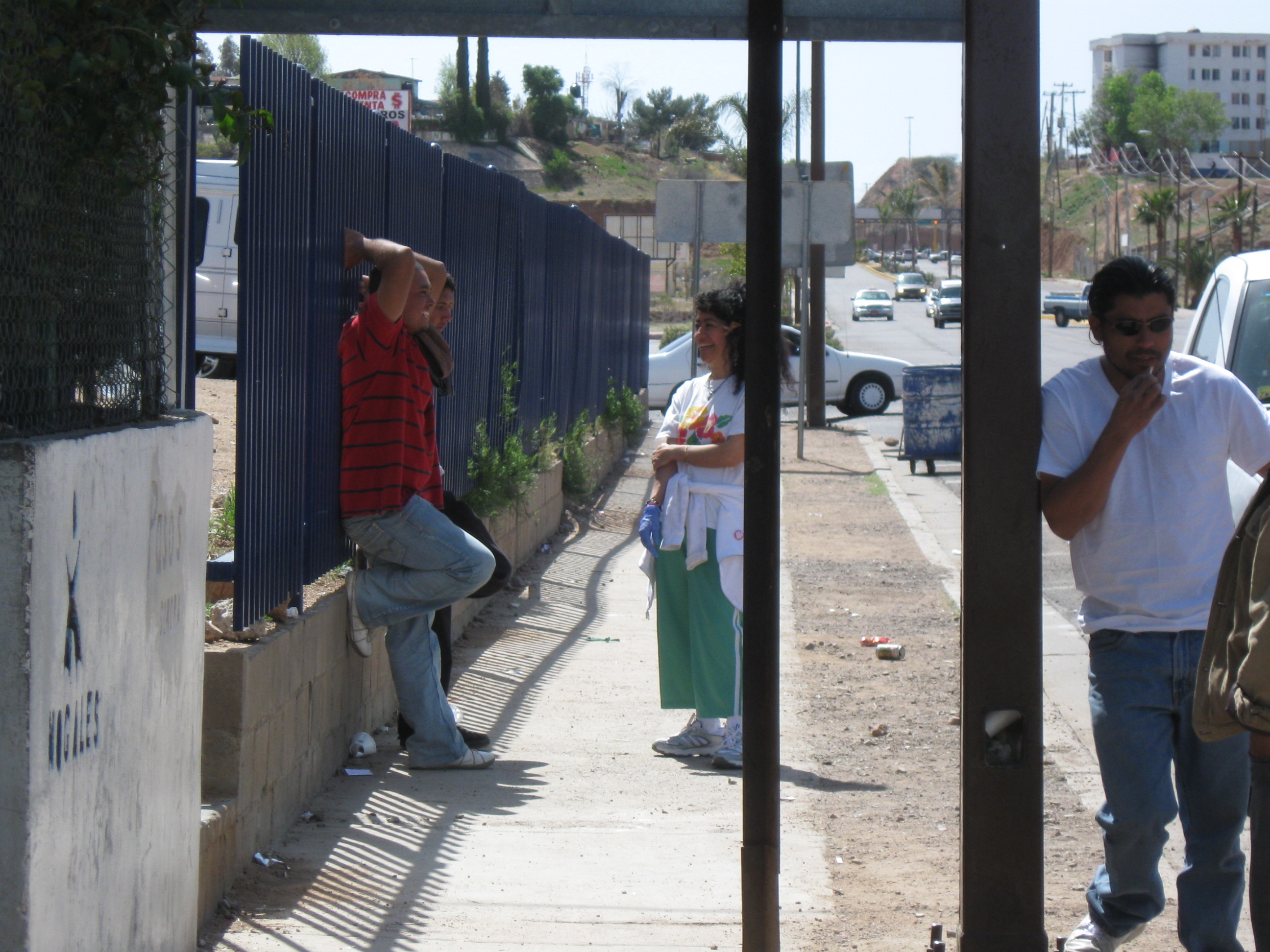Speaking with people outside the Deported Migrant Service Center.