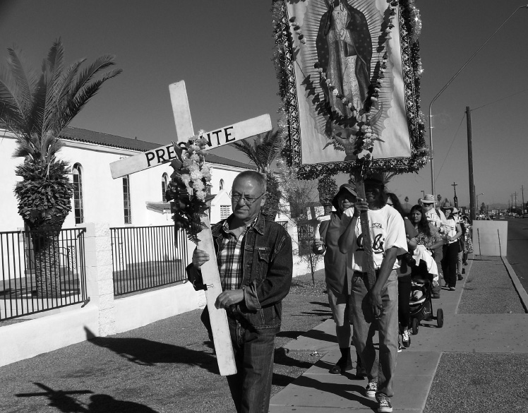 Walkers in the Día de Los Muertos (Day of the Dead) Pilgrimage leave St. John's Church in Tucson on October 31 bearing 137 crosses to represent the migrant lives lost in the Arizona desert from October 1, 2014 to September 30, 2015. The Coalición de Derechos Humanos (Human Rights Coalition) sponsors the annual eight-mile walk. Photo by Denise Holley.