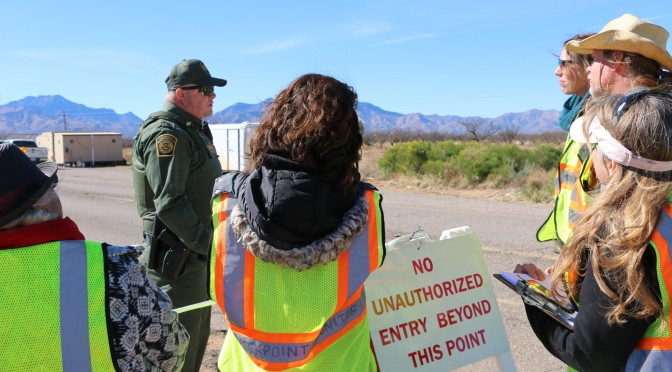 Observers from People Helping People in Arivaca, Arizona monitor a Border Patrol checkpoint, located 26 miles north of the Mexico border on Highway 286, to prevent harassment and document any abuses against motorists. Agents were diplomatic to the group and allowed them to observe the primary inspection area, but they erected barricades when the monitors returned the next day. Photo: Liza Corr.